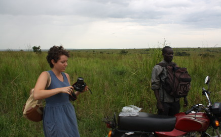 SU Local Coordinator Ben Ocan takes a break from driving American volunteers Kelly Curran to Amuru by motorcycle.